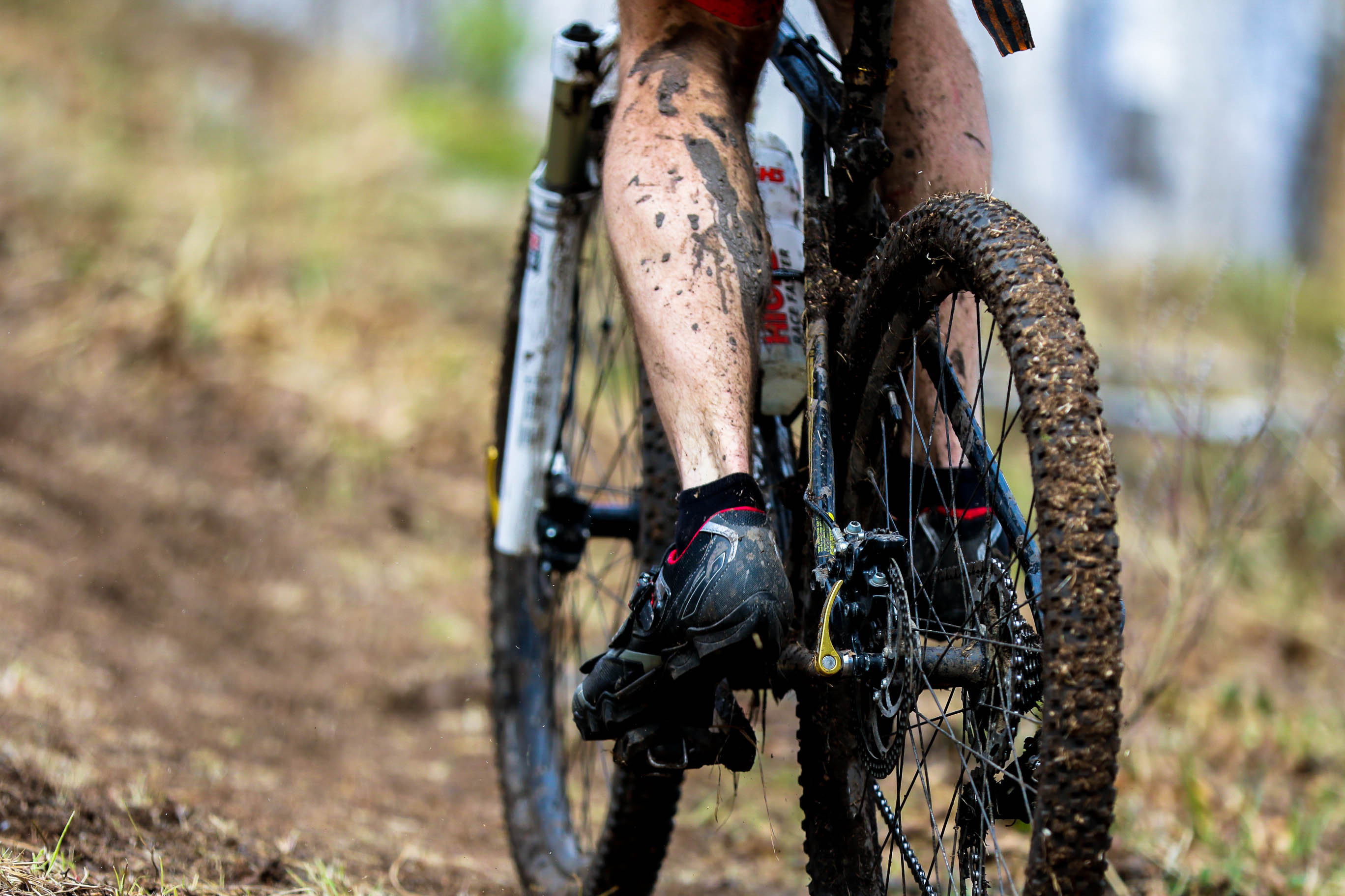 Muddy bike rider